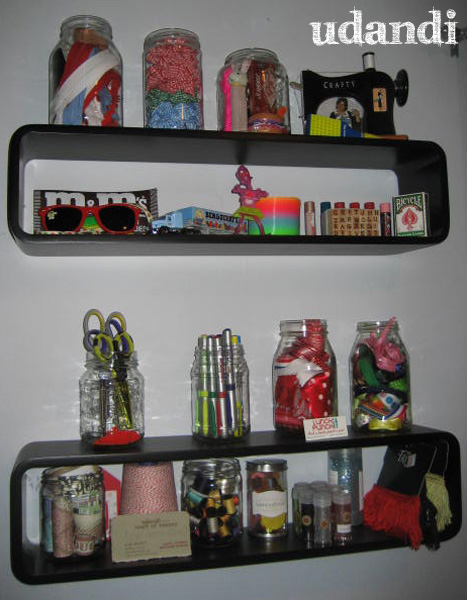craft room shelves of ribbon pens glitter toys